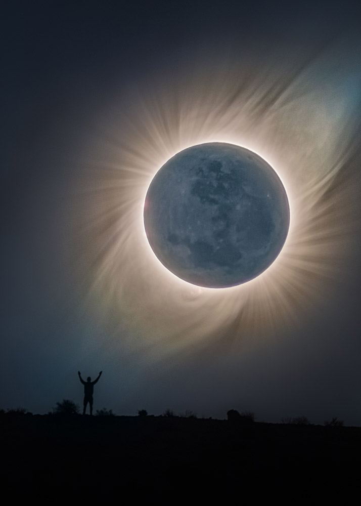 Man over the solar eclipse in the Andes (Chile) by Michael Ostaszewski