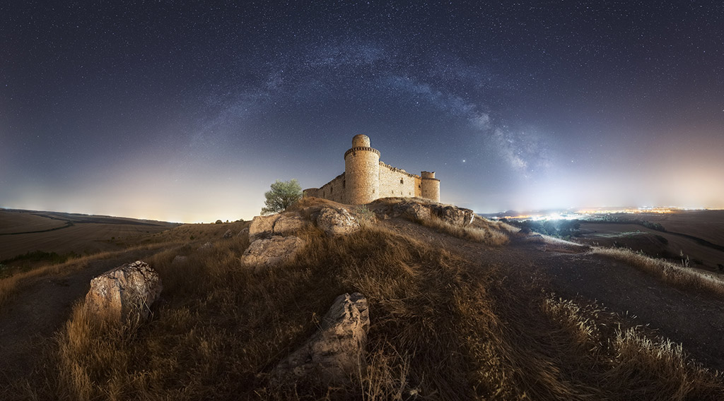 Milky Way arch over the Barcience castle in Toledo (Spain) by Luis Cajete