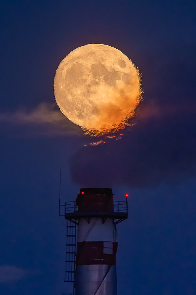 Full Moon over an industrial chimney in Spain by Jesús Manzaneque