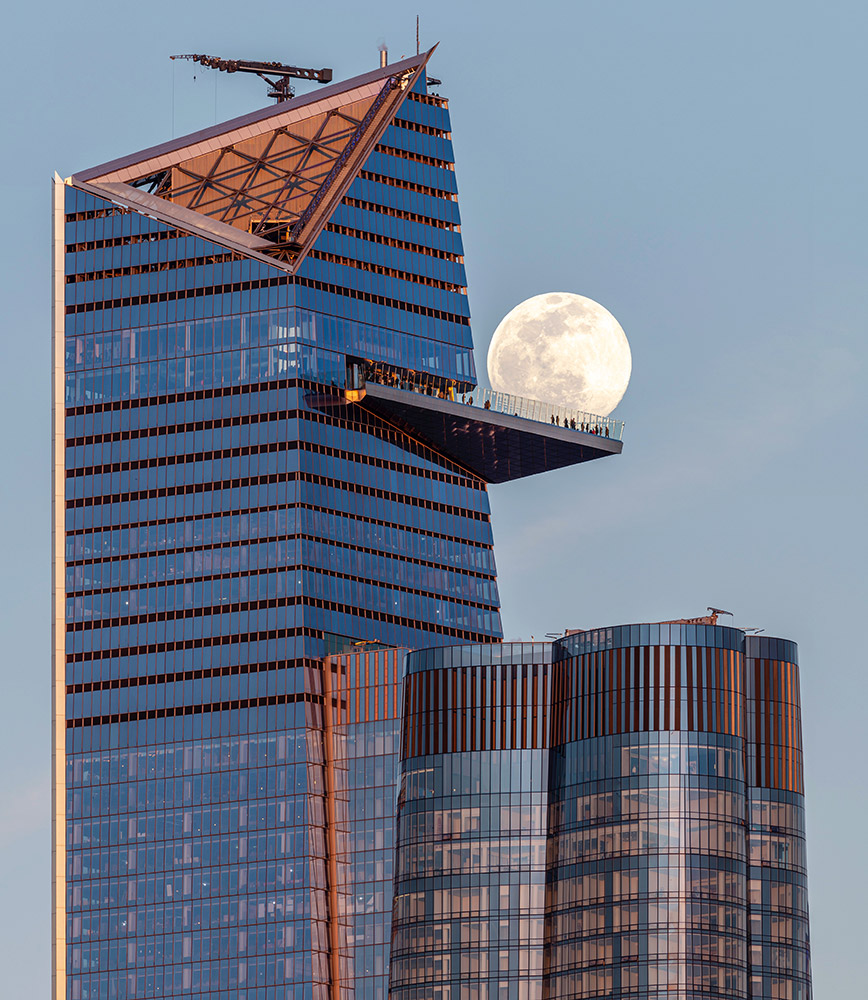 Full Moon behind the Edge NYC sky deck in New York City (USA) by Jeff Casey